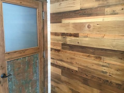 Barn wood wall and door made from hand hewn boards