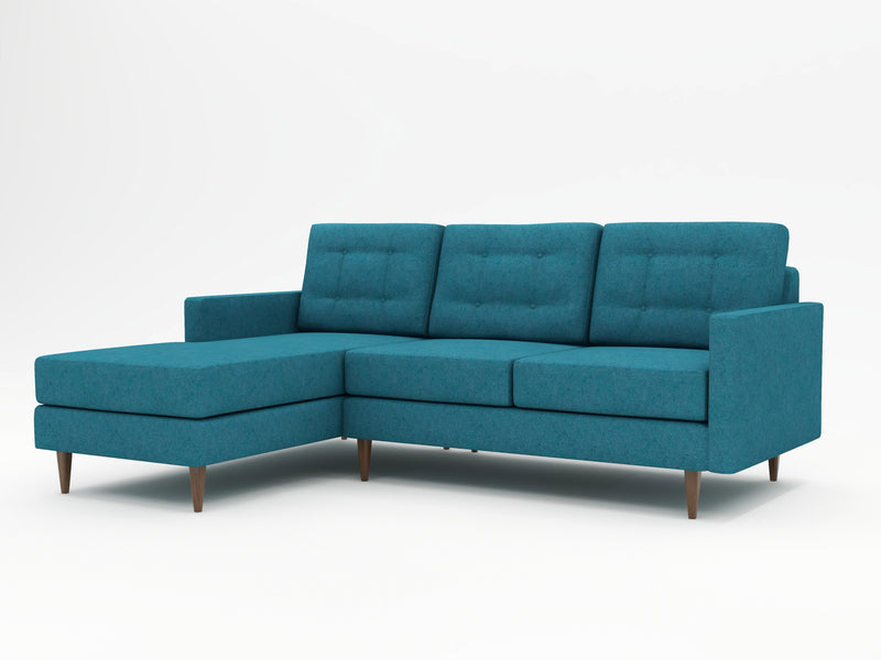 A high profile sofa with a chaise return on the left side as you view it