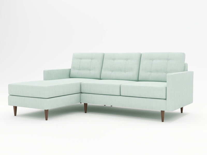 A contemporary sofa with chaise and a sophisticated icy blue color profile