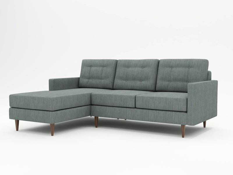 A higher profile stance on a grey modern styled sofa with a left hand chaise return