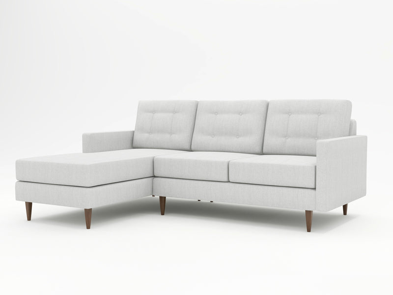 A brilliant combination of silvery-grey uphosltery and wooden feet on a unique sofa