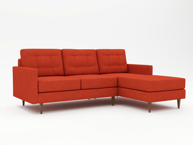 Eclectic deep orange couch with a chaise return on the right side as viewing from the front