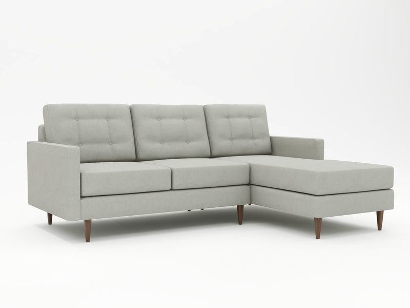 Neutral grey couch with a right hand chaise lounge inclusion