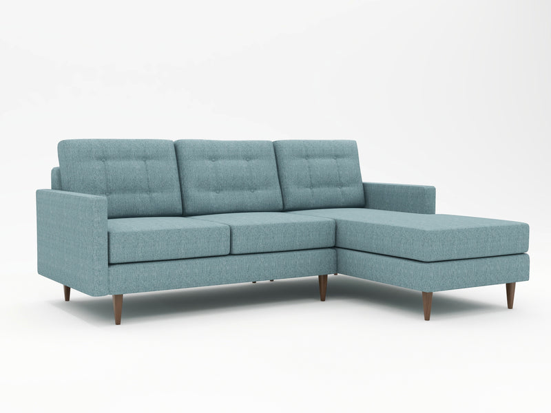 Multi-faceted blue color on the upholstery of this sofa with right hand chaise