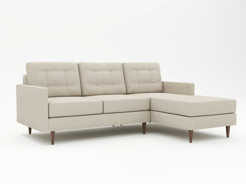 Upright stance sofa chiase with spindle style feet in wood
