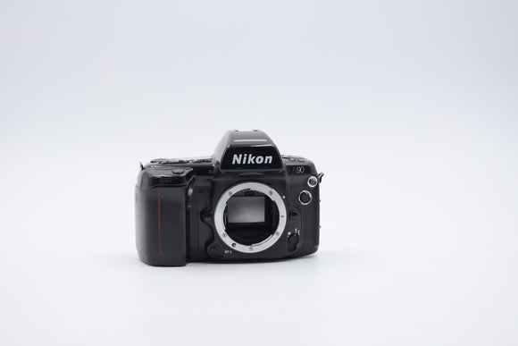 Nikon Pro/Am camera top model with a flash built in