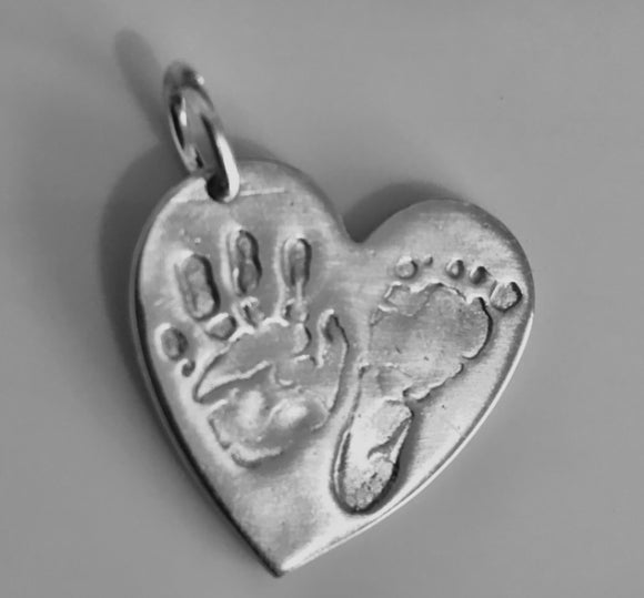 Medium hand and footprint pendants prices starting from....