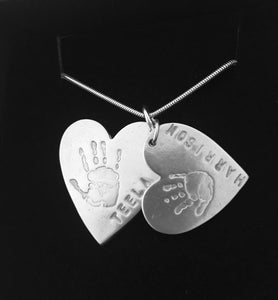 Double descending hand/footprint necklace prices starting from....