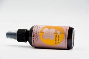 Coconut hydrating mist with hibiscus and rose sideways bottle