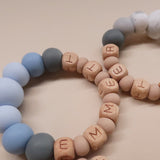 "Zao&Co ""Emma"" Personalized teething ring blue tones"