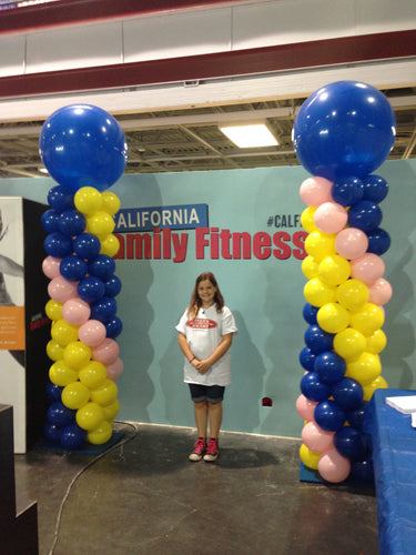Ten foot tall balloon pillars in blue, yellow and pink used in a trade show booth for California Family Fitness