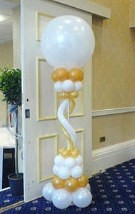 Eight foot tall balloon pillar in white and gold.  Large 36 inch balloon on the top