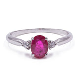 MODERN STYLE RING IN 18K GOLD WITH CENTRAL RUBY AND 2 DIAMONDS