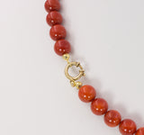 Vintage red coral ball necklace with 14k gold clasp