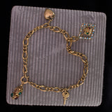 Antique 18K gold bracelet with charms, early 900s