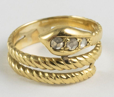Anello in oro a forma di serpente con rosette di diamante , anni '60 - Antichità Galliera