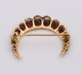 Vintage gold brooch with garnets from the 50s