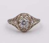 Antique white gold ring with central diamond and small rosettes, 30s