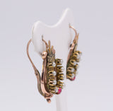 Bourbon earrings in gold with beads and red stone. Second part of the 800th century