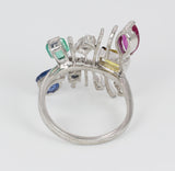 Vintage white gold ring with diamonds, sapphires, ruby, emerald and topaz. 70's