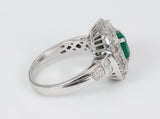Vintage white gold ring with emerald and brilliant and baguette cut diamonds