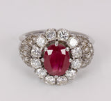 Platinum ring with central ruby ​​(2.5 ct) with brilliant cut diamonds (1.2 ct). 60's