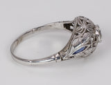 Antique 18k white gold ring with central diamond (approx.0.25 ct) and sapphires, 30s