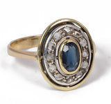 Vintage 18k gold ring with central sapphire and diamond rosettes, 40s