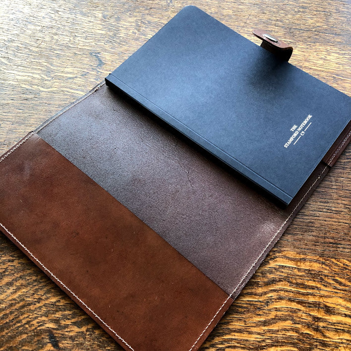Open Burghley Leather Refillable Journal showing replaceable book