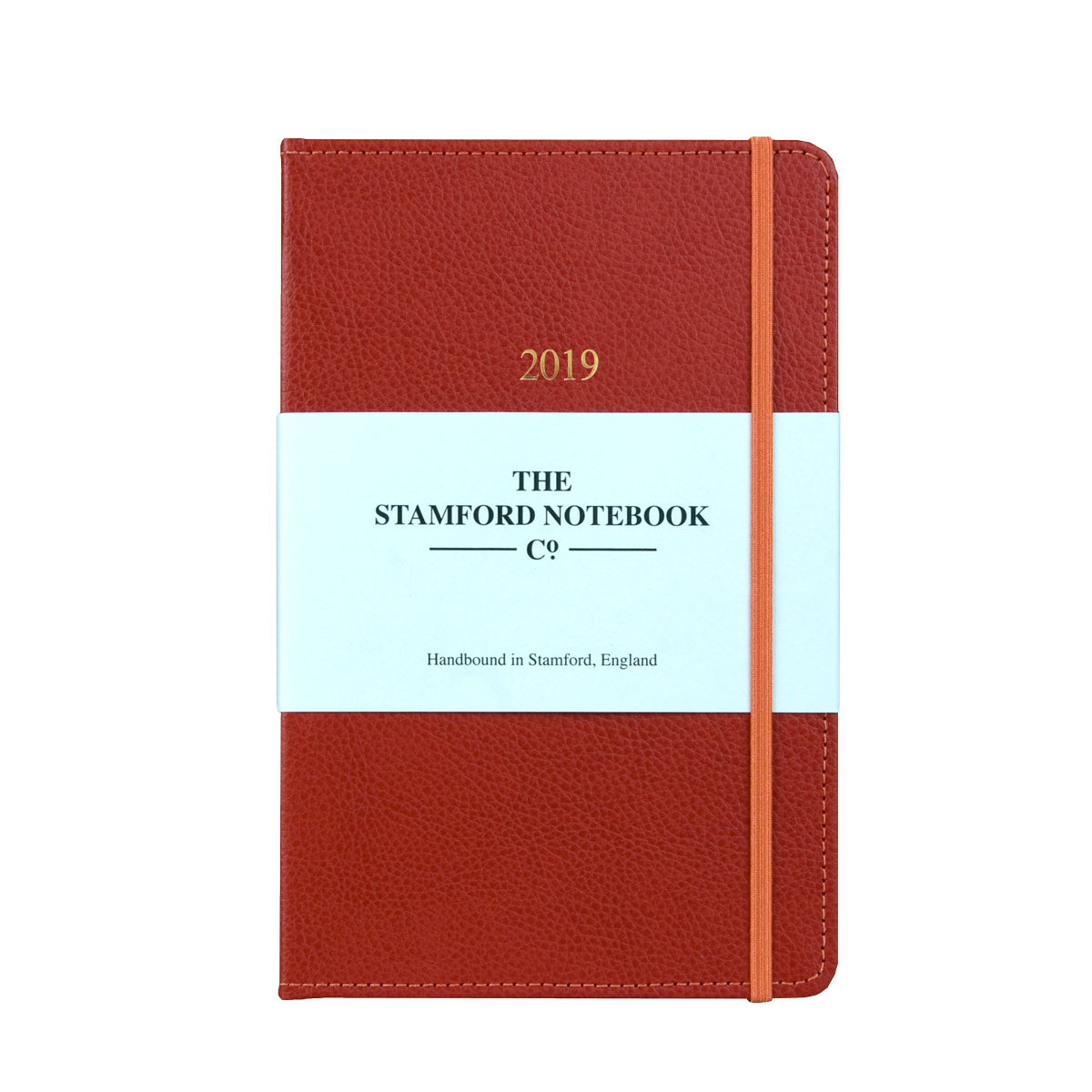 red leather diary with orange stitching