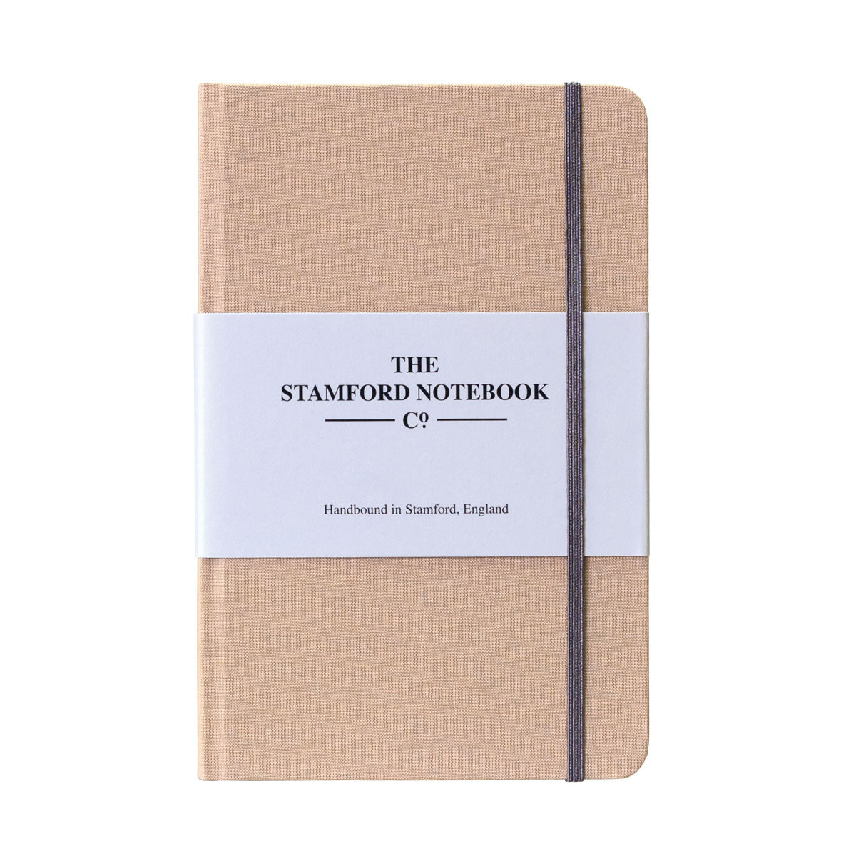 beige woven cloth handbound notebook