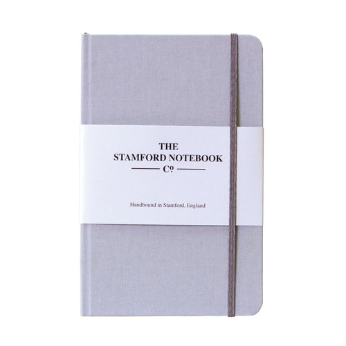 light grey woven cloth handbound notebook