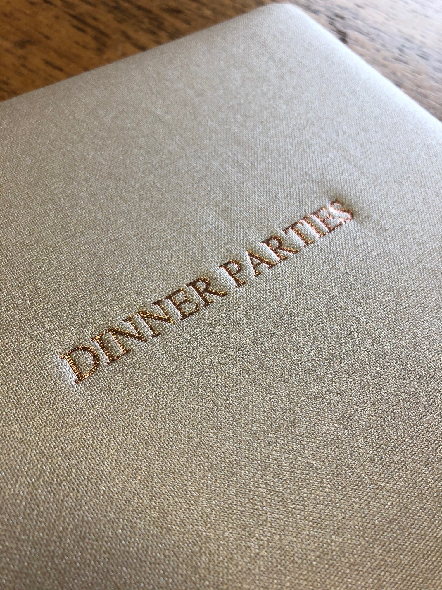 Text Image of Metallic Buckram Dinner Party Book in Champagne