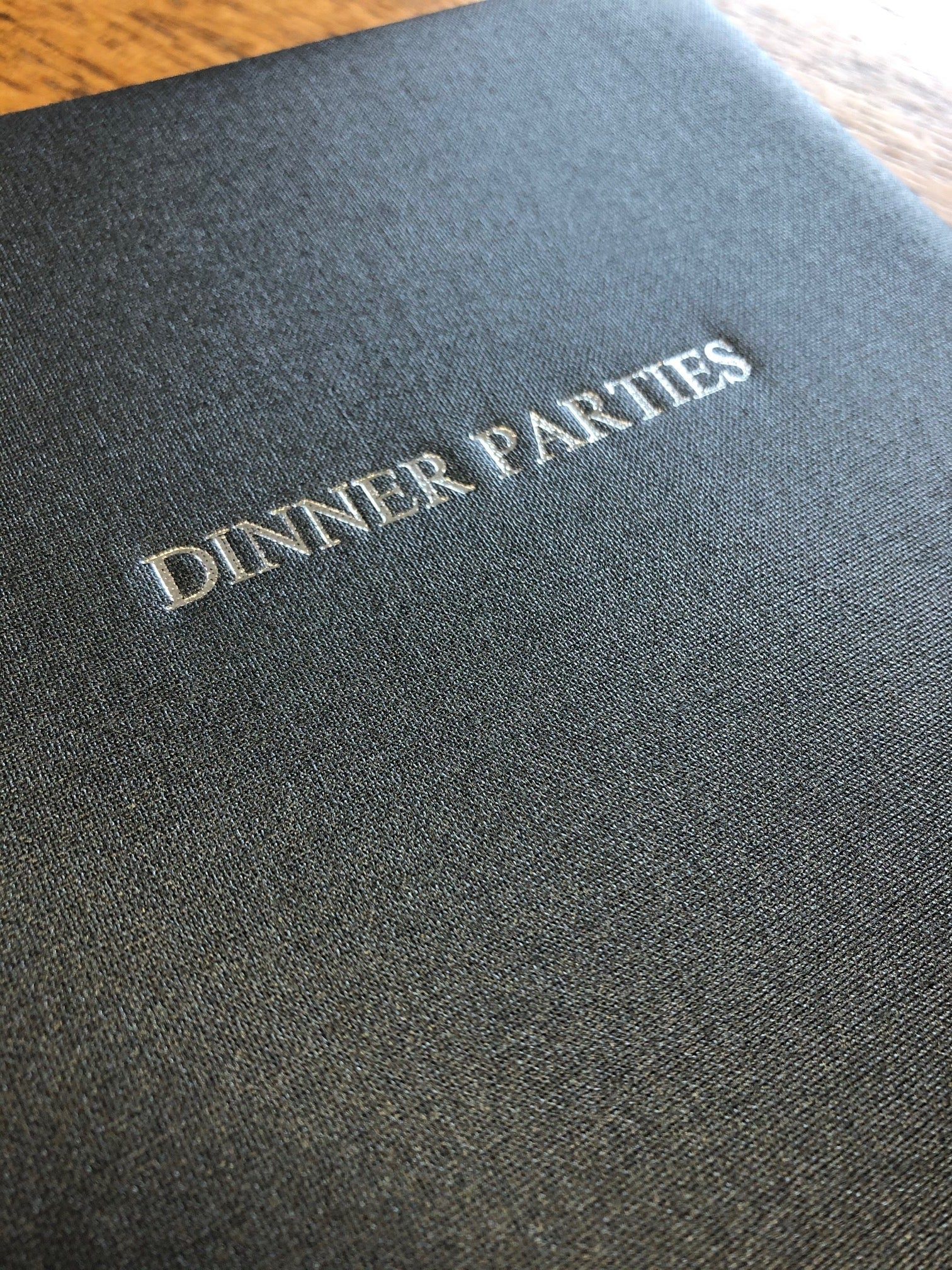 Text Image of Steel Grey Metallic Buckram Dinner Party Book