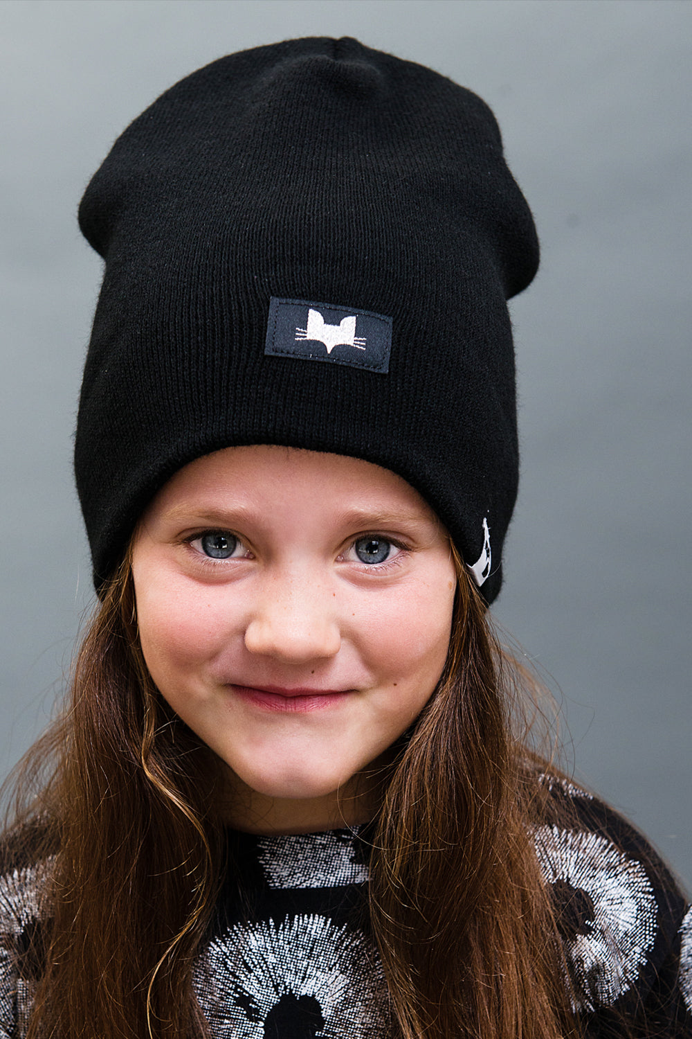 Unisex foxy beanie. Metallic silver logo badge, made and designed in the uk.