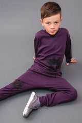 100% cotton jersey joggers with star splat ink design in punch plum, made and designed in Britain