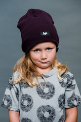 Unisex super soft beanie. Available in black and punchy plum.
