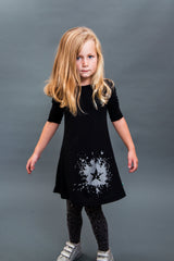 Super soft black jersey dress with shimmering star splat. Made and designed in Britain using chemical free inks.