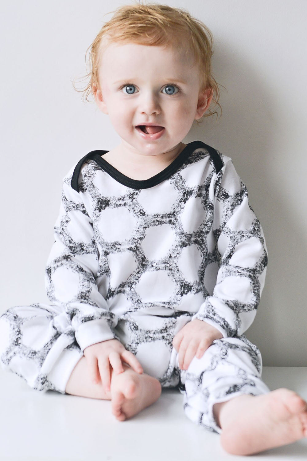 Super soft 100% cotton baby romper, vegan friendly and made in Britain.