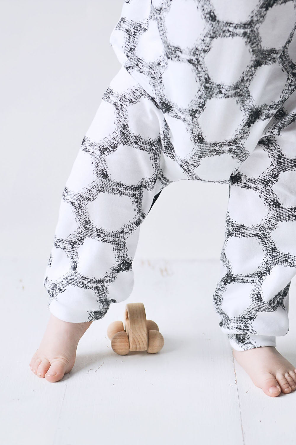 unisex baby romper for 0 to 18 months. Vegan friendly and made in the uk.