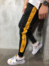 Latest Trend Black Joggers with Yellow Strips Mens_Fashion Sale