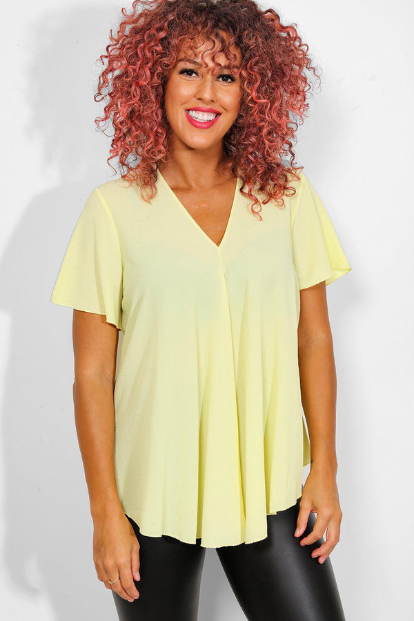 Yellow Back Zip Dip Hem Top