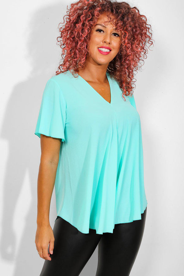 Aqua Back Zip Dip Hem Top