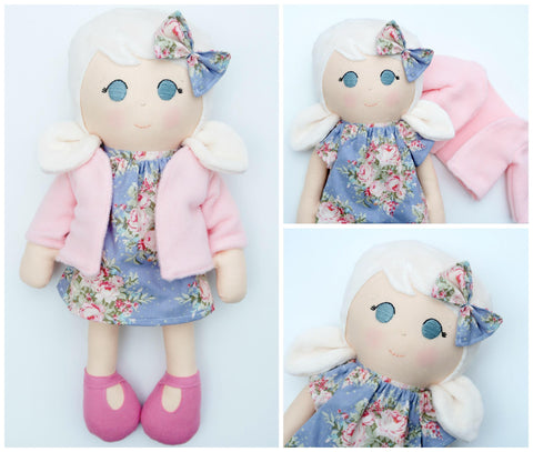 handmade blonde doll in pink coat