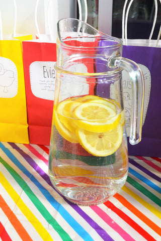 jug of water with lemons in