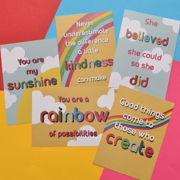 Five colourful postcards with inspirational quotes on a colourful background. They have clouds and rainbow backgrounds