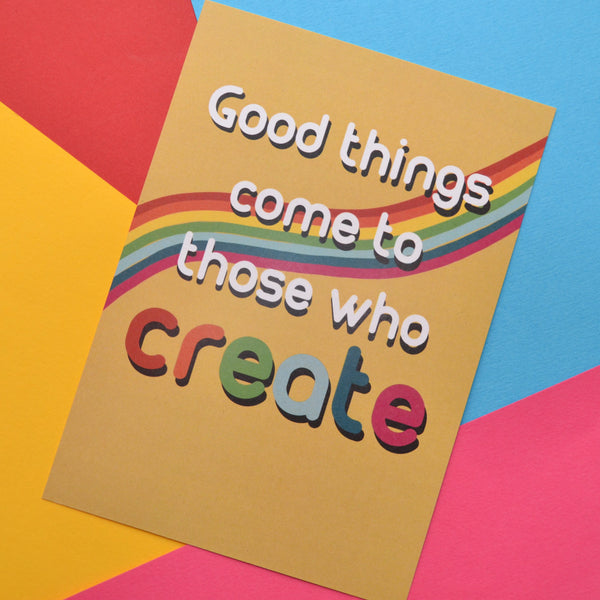Good things come to those who create in white and rainbow colours on a yellow and rainbow background
