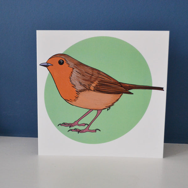 A digitally illustrated card of a robin on a green spot background