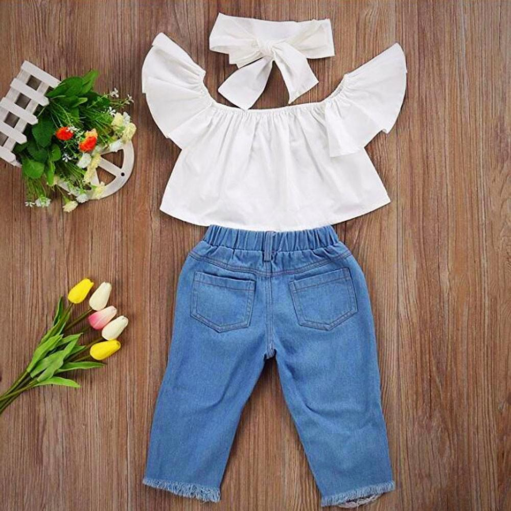 Off shoulder top with denim pants and a headband