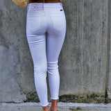 Mid-Rise Distressed White Skinny Jeans